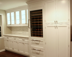 white painted kitchen lighted csabinet